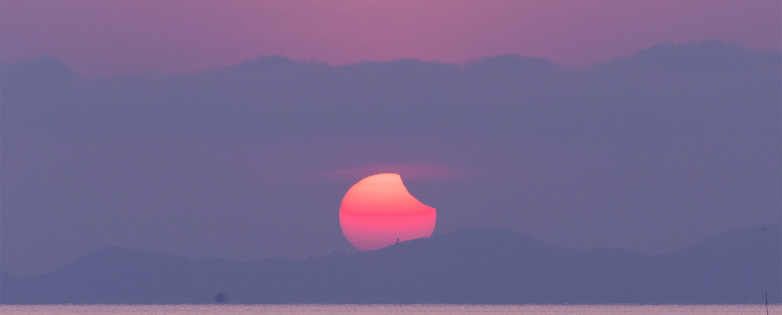 Solar Eclipse Sunrise over Mountains